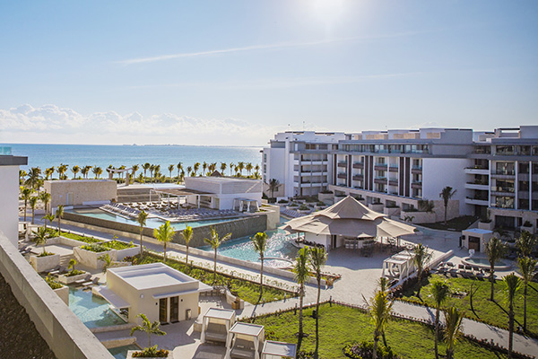 outdoor areas and swimming pools at majestic elegance playa mujeres